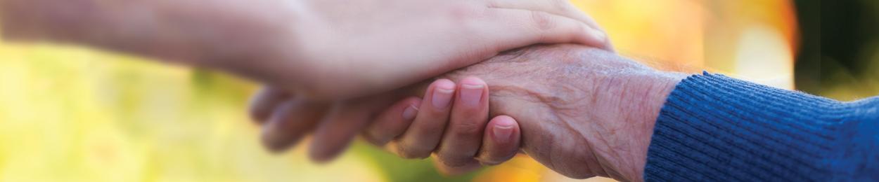 Mains enlacés en soutien au cancer de la prostate